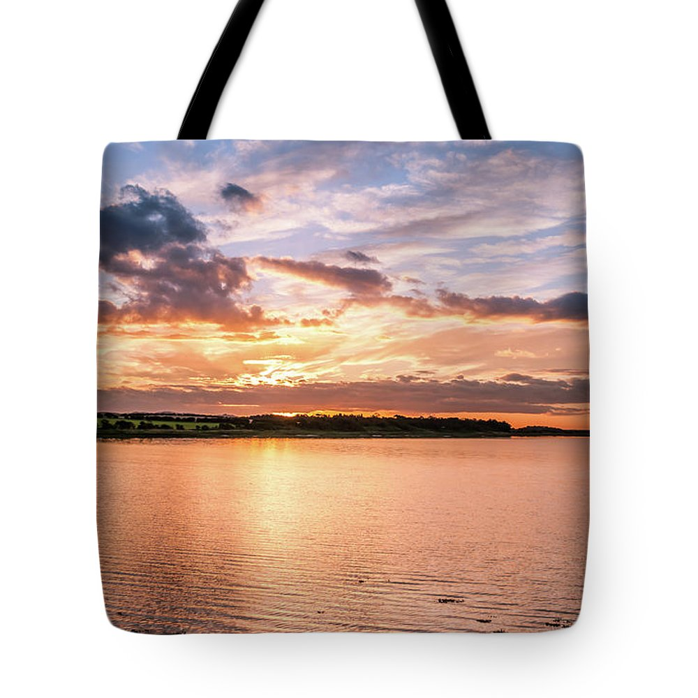 Budle Bay Seascape Tote Bag featuring the photograph Sunset Over The Bay.......... by Naylors Photography