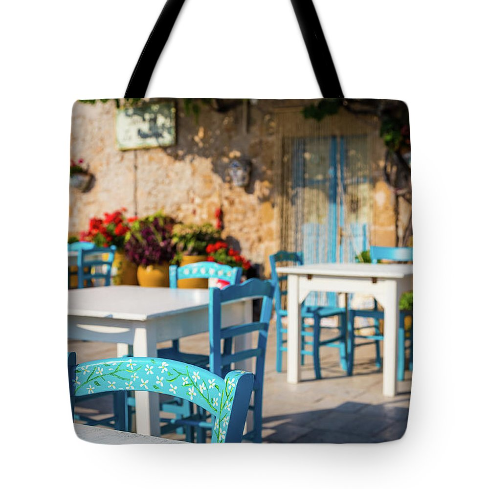 Blue Tote Bag featuring the photograph Tables In A Traditional Italian Restaurant In Sicily, Italy by Paolo Modena