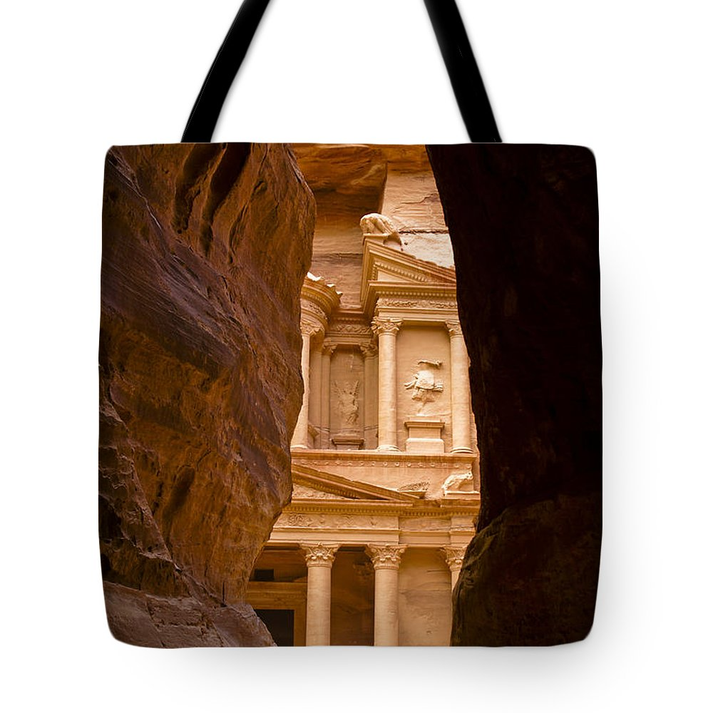 Middle East Tote Bag featuring the photograph The Treasury Of Petra by Michele Burgess