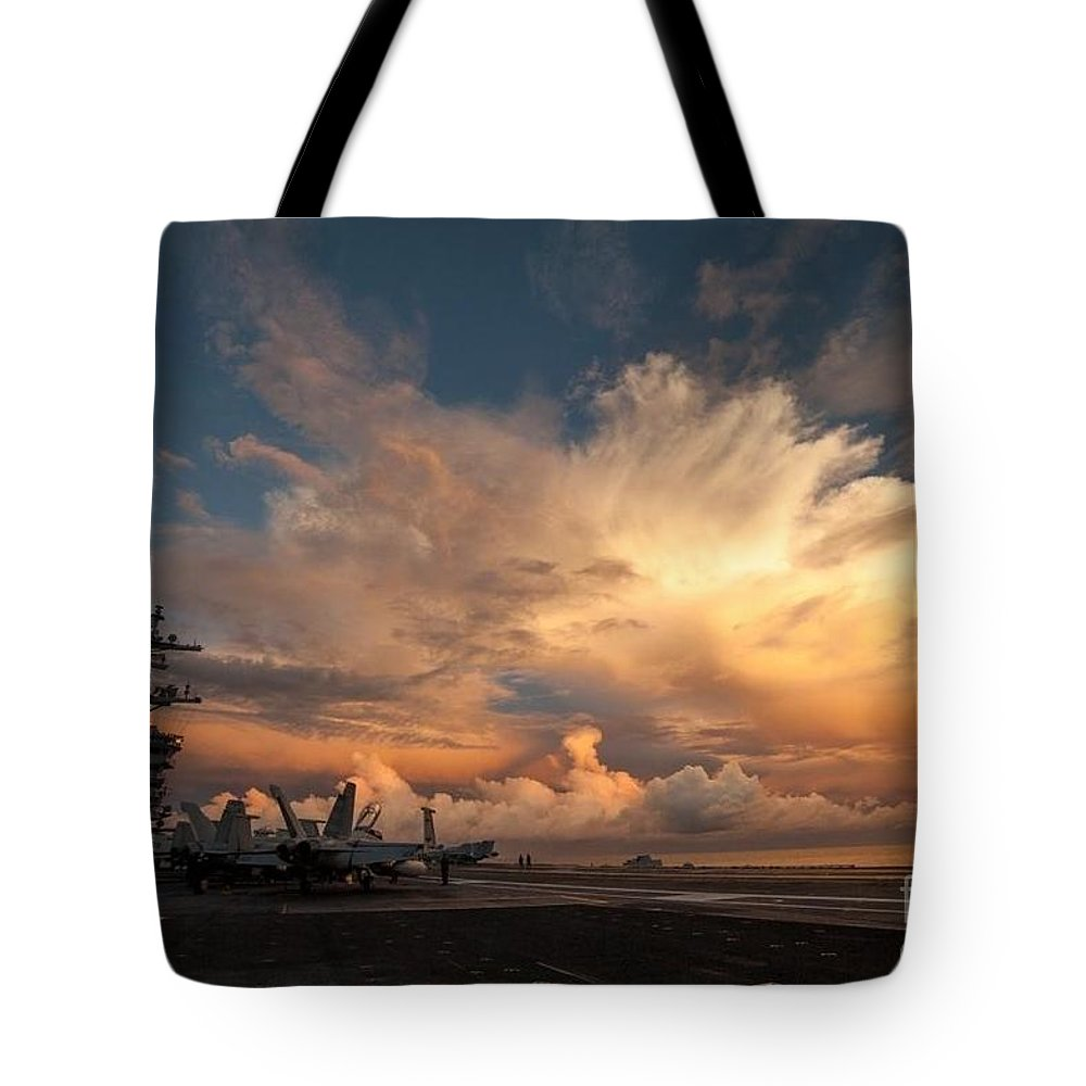 Uss Carl Vinson (cvn 70) Credit Us Navy Tote Bag featuring the painting Uss Carl Vinson by Celestial Images