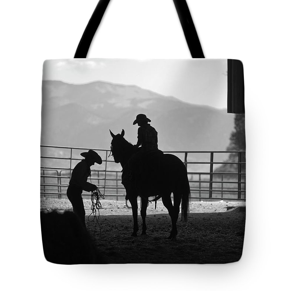 Rocky Mountains Tote Bag featuring the photograph 201208107-047k Cowgirls Preparing To Ride 2x3 by Alan Tonnesen