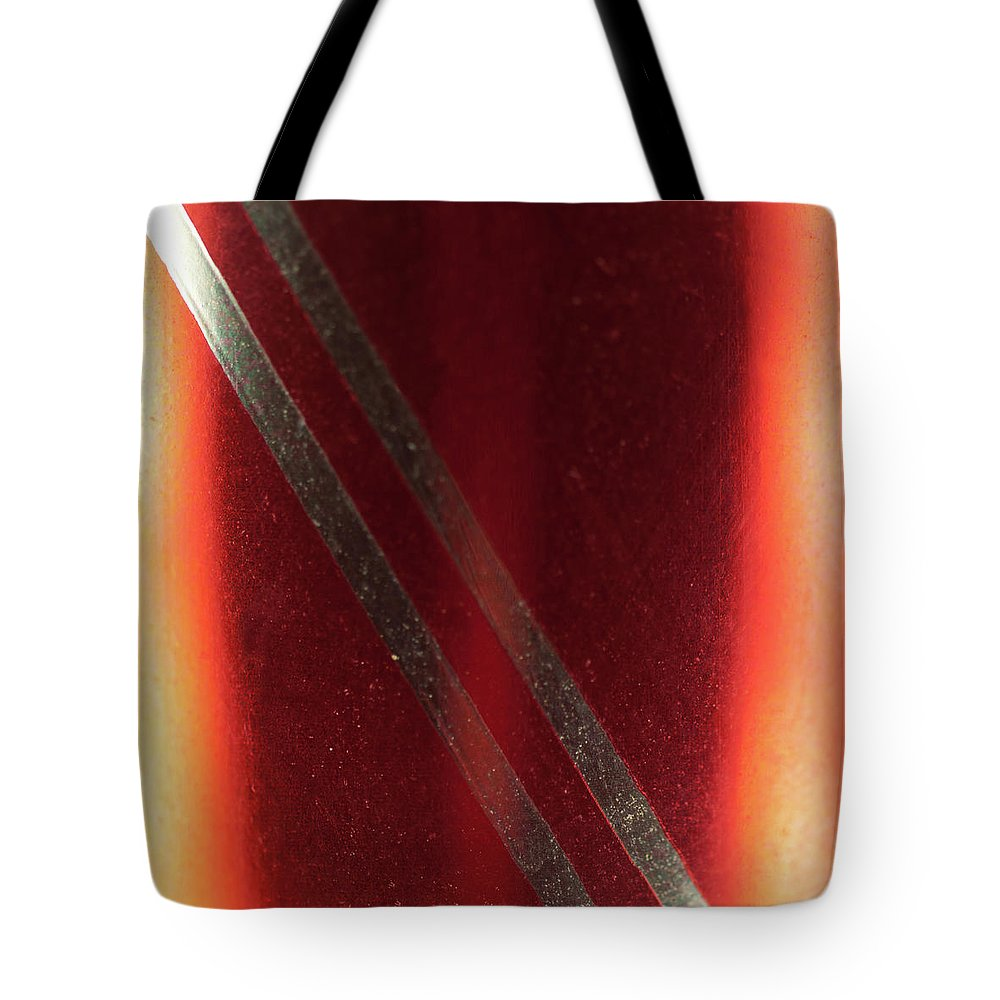 Red Tote Bag featuring the photograph Macro Of Everyday Object by Diane Schuler
