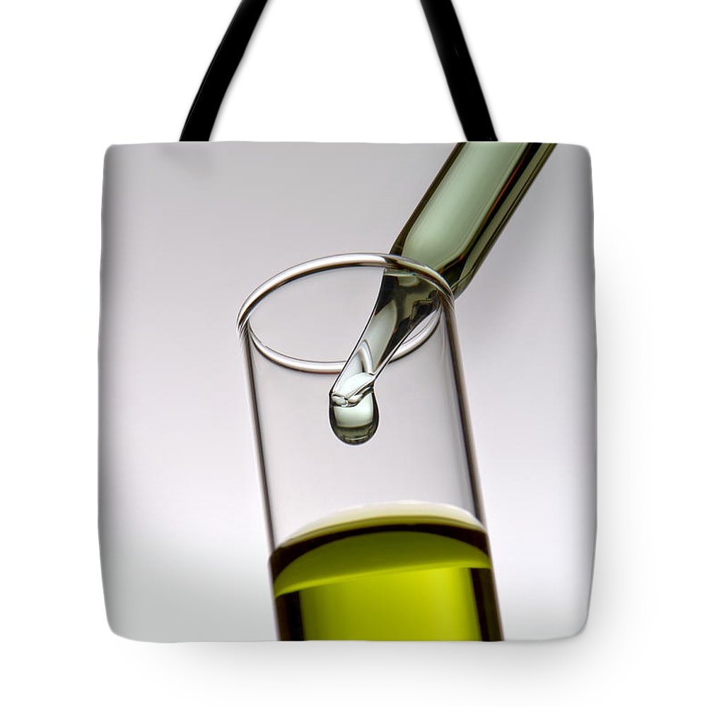 Chemical Tote Bag featuring the photograph Scientific Experiment In Science Research Lab by Olivier Le Queinec