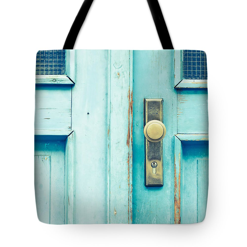 Aged Tote Bag featuring the photograph Blue Door by Tom Gowanlock