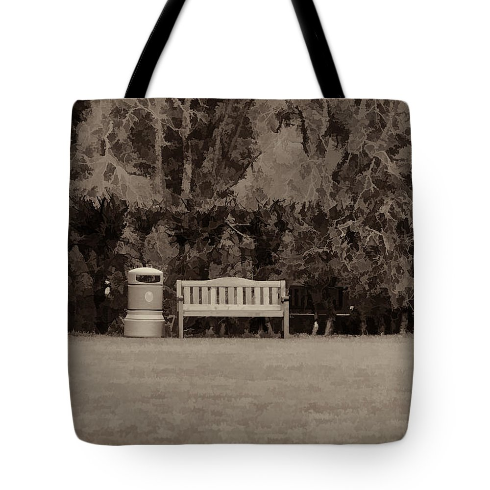 Bench Tote Bag featuring the photograph A Trash Can And Wooden Benches In A Small Grassy Area by Ashish Agarwal