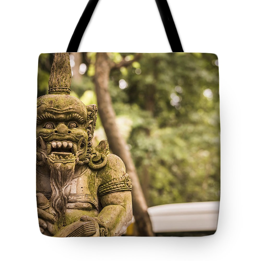 Architecture Tote Bag featuring the photograph Bali Sculptures by Jijo George