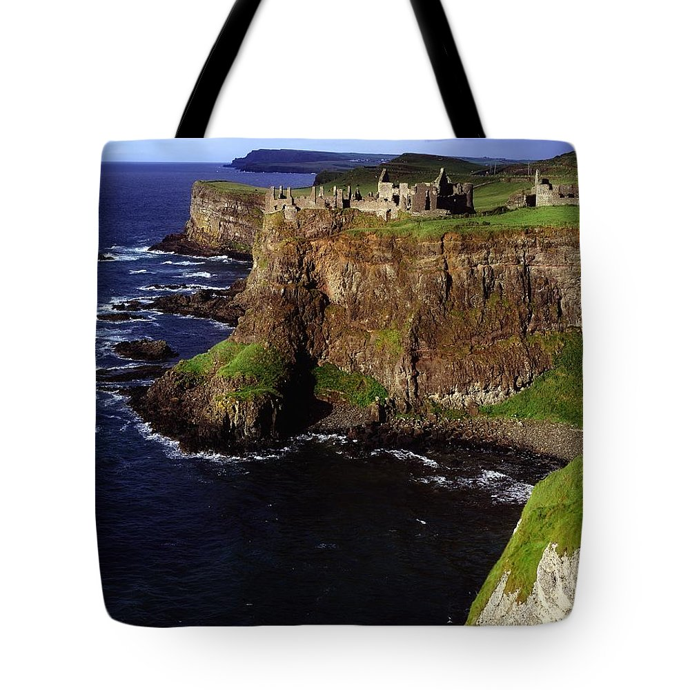 Architectural Exteriors Tote Bag featuring the photograph Dunluce Castle, Co. Antrim, Ireland by The Irish Image Collection