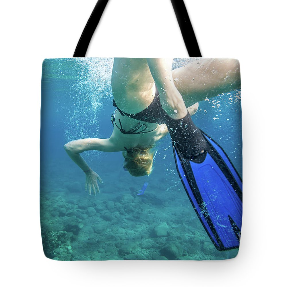 Snorkeling Tote Bag featuring the photograph Female Snorkeling by Benny Marty