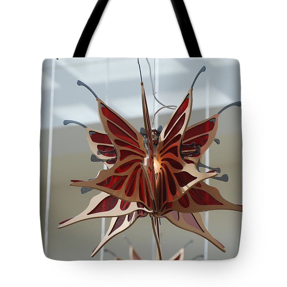 Architecture Tote Bag featuring the photograph Hanging Butterfly by Rob Hans