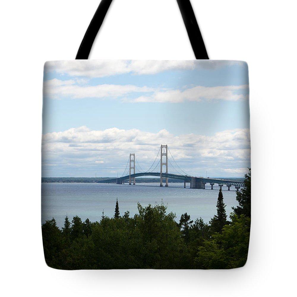 Mackinaw Bridge Tote Bag featuring the photograph In The Distance by Linda Kerkau