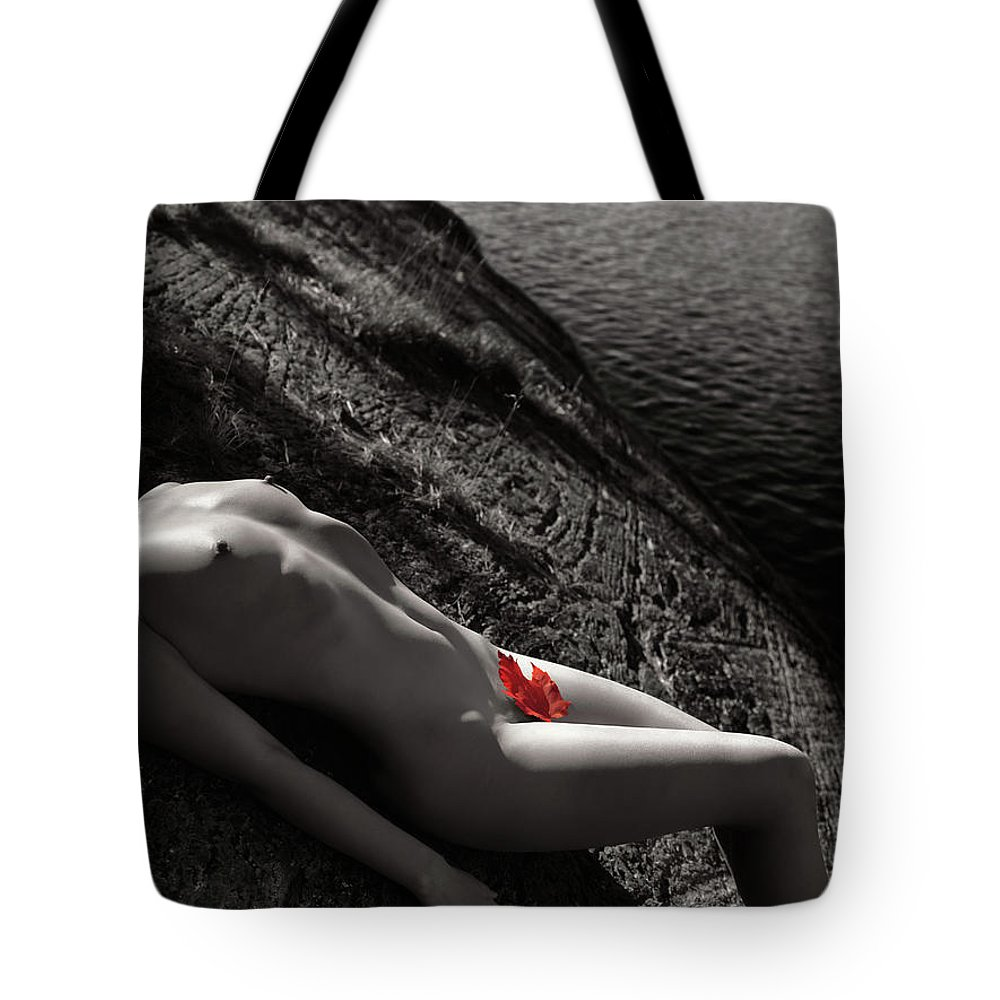 Nude Tote Bag featuring the photograph Nude Woman Lying On Rocks By The Water by Oleksiy Maksymenko