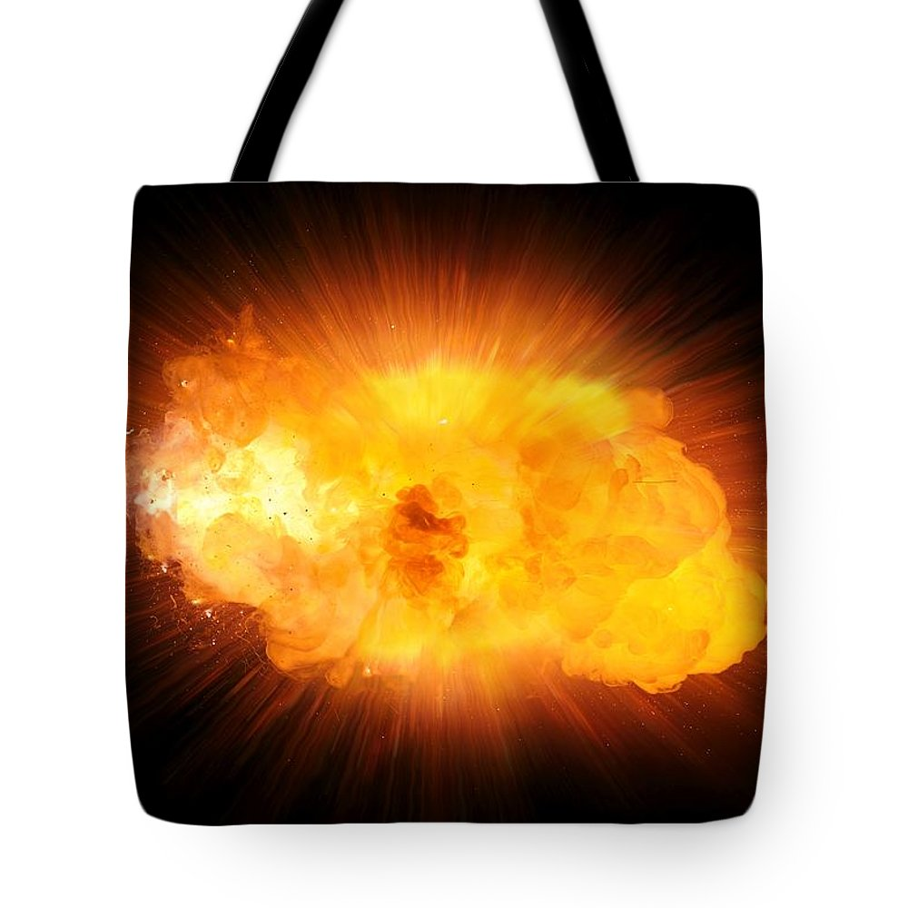Fire Tote Bag featuring the photograph Realistic Fire Explosion, Orange Blast With Sparks Isolated On Black Background by Lukasz Szczepanski