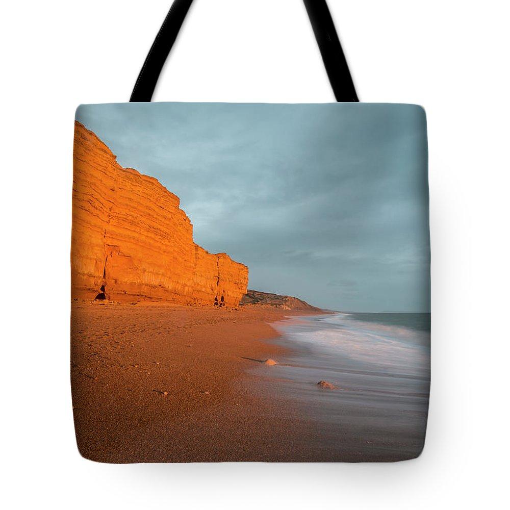 Burton Bradstock Tote Bag featuring the photograph Beautiful Vibrant Sunset Landscape Image Of Burton Bradstock Gol by Matthew Gibson