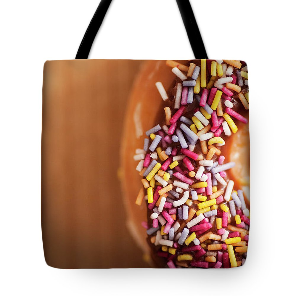 Donut Tote Bag featuring the photograph Donut And Sprinkles by Samuel Whitton