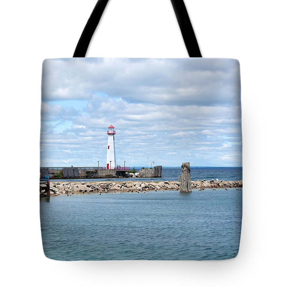 St. Ignace Lighthouse Tote Bag featuring the photograph Lots Of Blue by Linda Kerkau