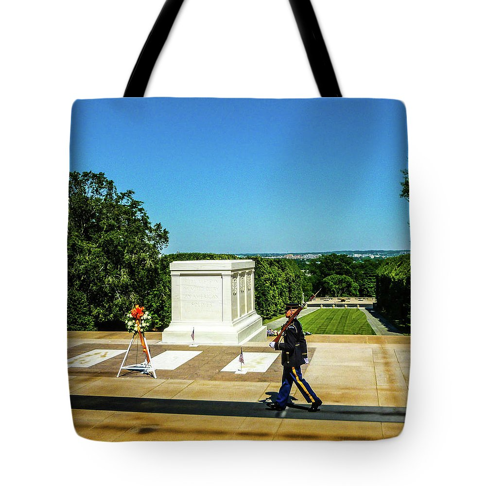 This Is A Photo Of One Of The Sentries Walking Their Post At The Tomb Of The Unknown Soldiers Tote Bag featuring the photograph Tomb Of The Unknowns by William Rogers
