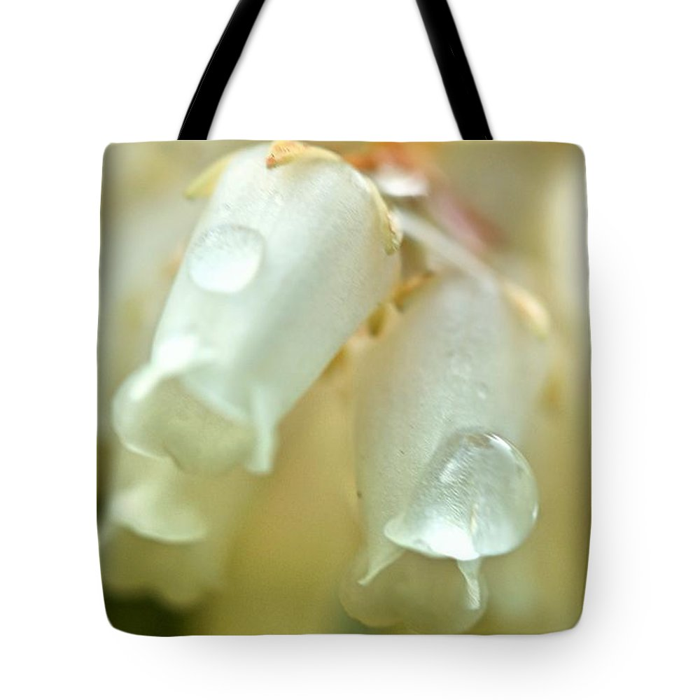 Tote Bag featuring the photograph Bloosome by Kanlayanee Irek