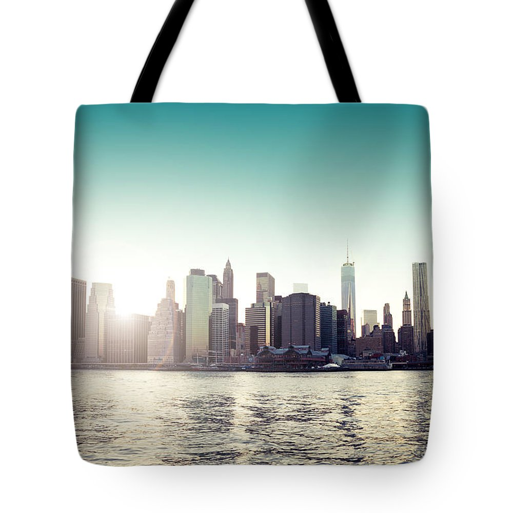 New York Tote Bag featuring the photograph View Of Lower Manhattan Skyscrapers And Huge Sky by Leonardo Patrizi