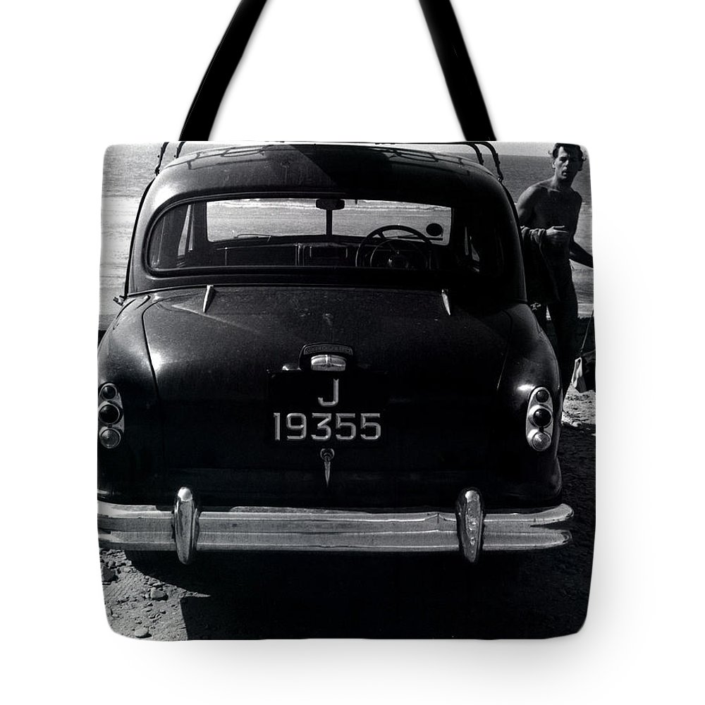 Surf Tote Bag featuring the photograph 50's Surfer by Charles Stuart
