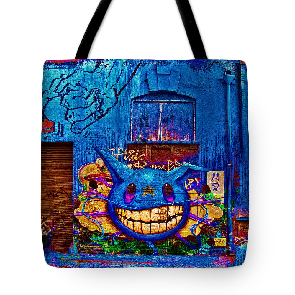 Grafitti Tote Bag featuring the photograph 540 by Chris Lord