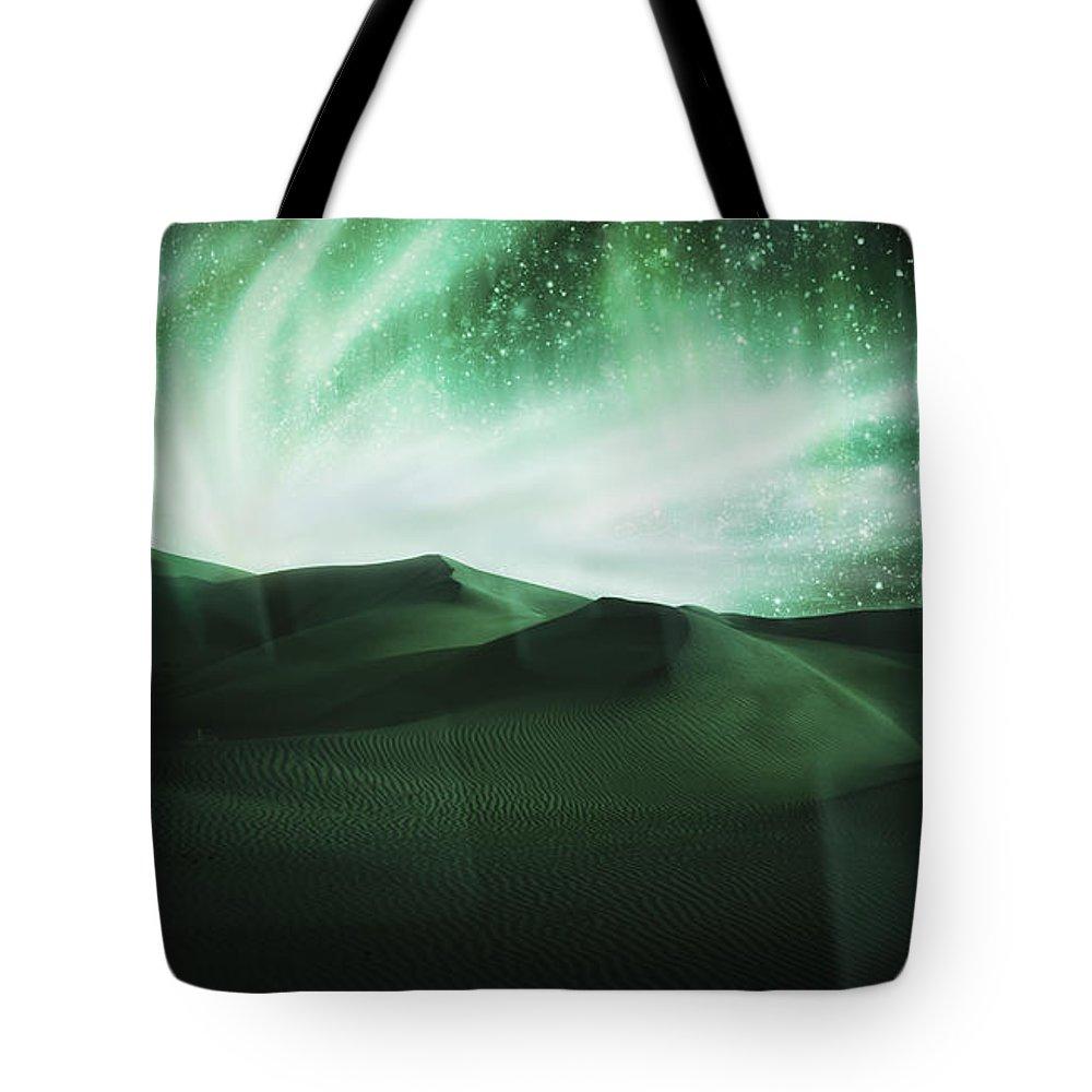 Above Tote Bag featuring the photograph Aurora Borealis by Setsiri Silapasuwanchai
