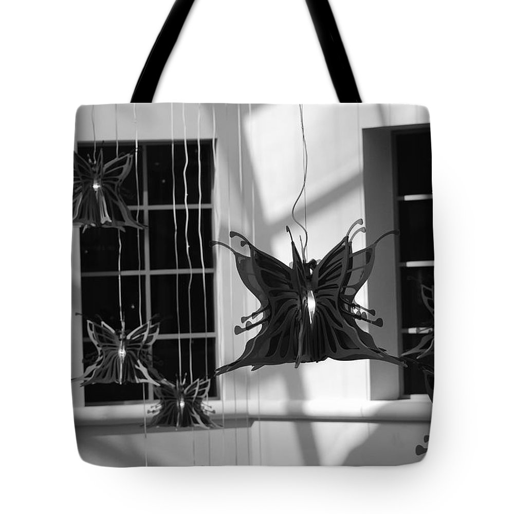 Black And White Tote Bag featuring the photograph Hanging Butterflies by Rob Hans