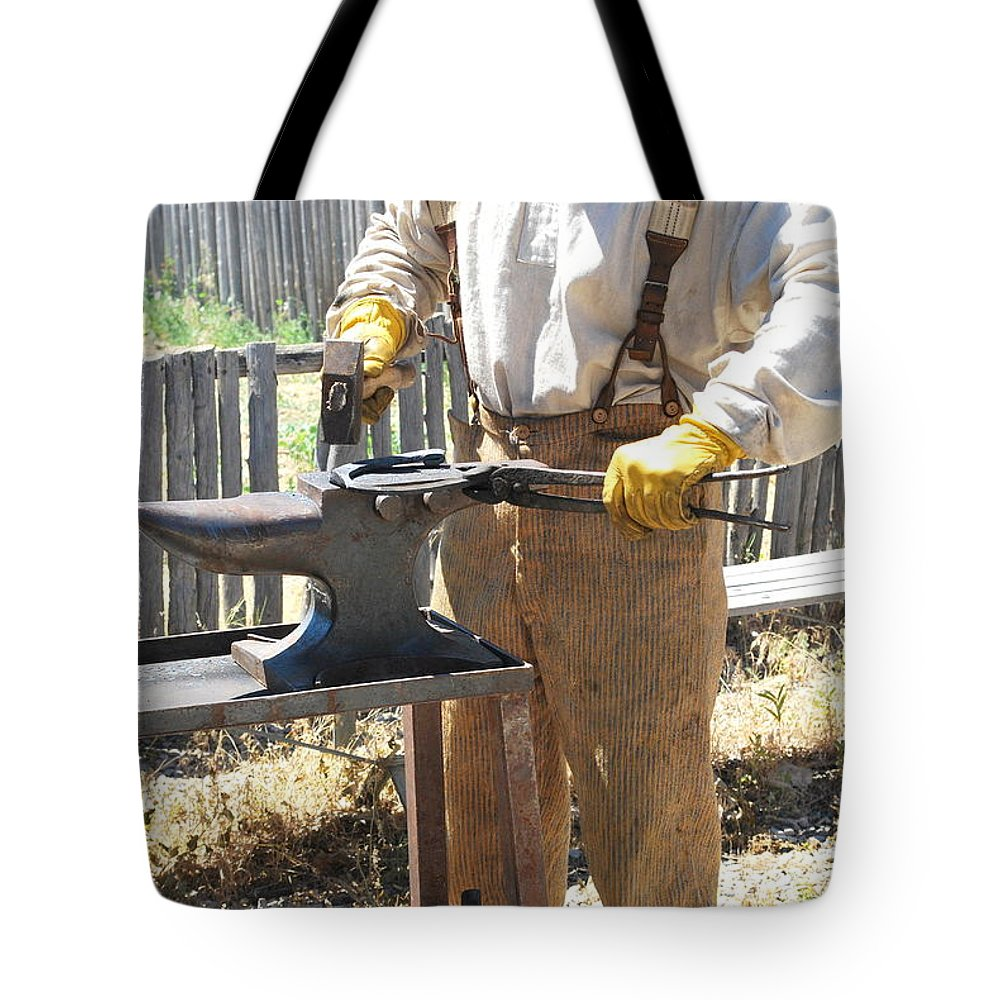 Man Tote Bag featuring the photograph Male Farrier. by Oscar Williams