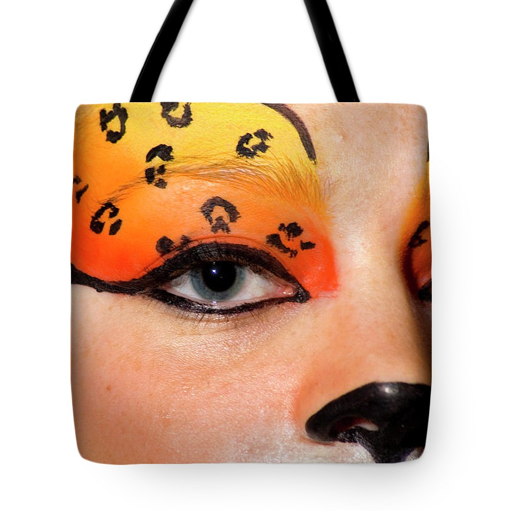 Psi Tote Bag featuring the photograph Young Female Model With Make Up Mask by Ilan Rosen