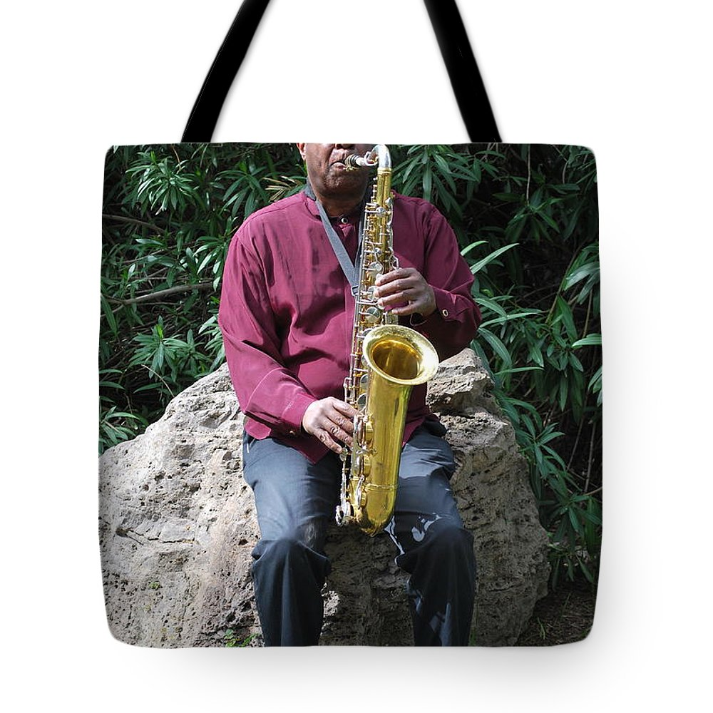 Muslim Tote Bag featuring the photograph Muslim Jazz Musician. by Oscar Williams