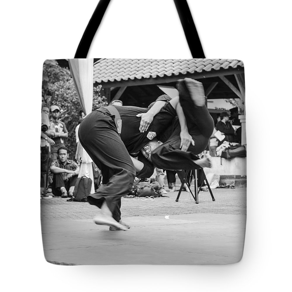 Martial Arts Tote Bag featuring the photograph Pencak Silat by Arie Toursino