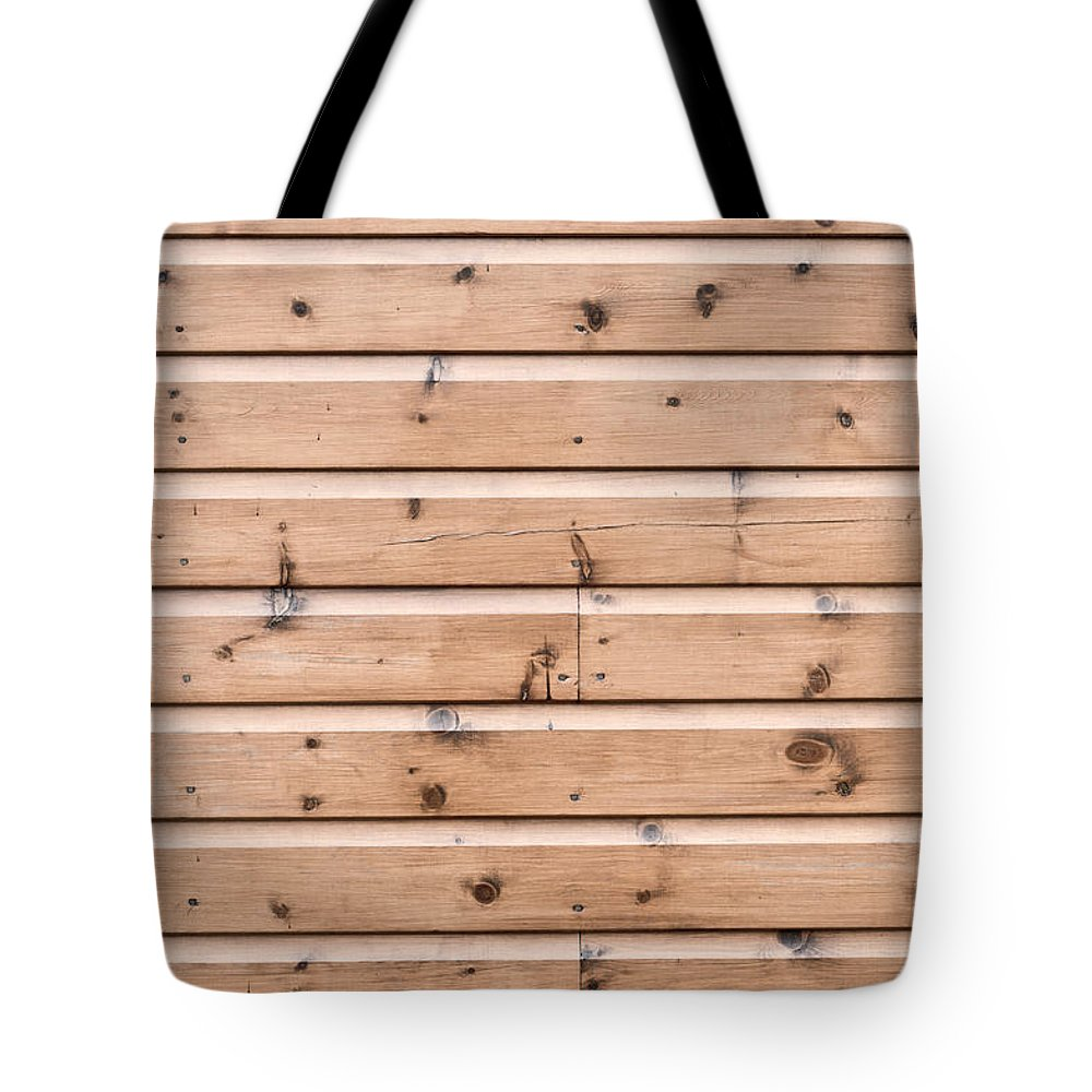 Abstract Tote Bag featuring the photograph Wooden Panels by Tom Gowanlock