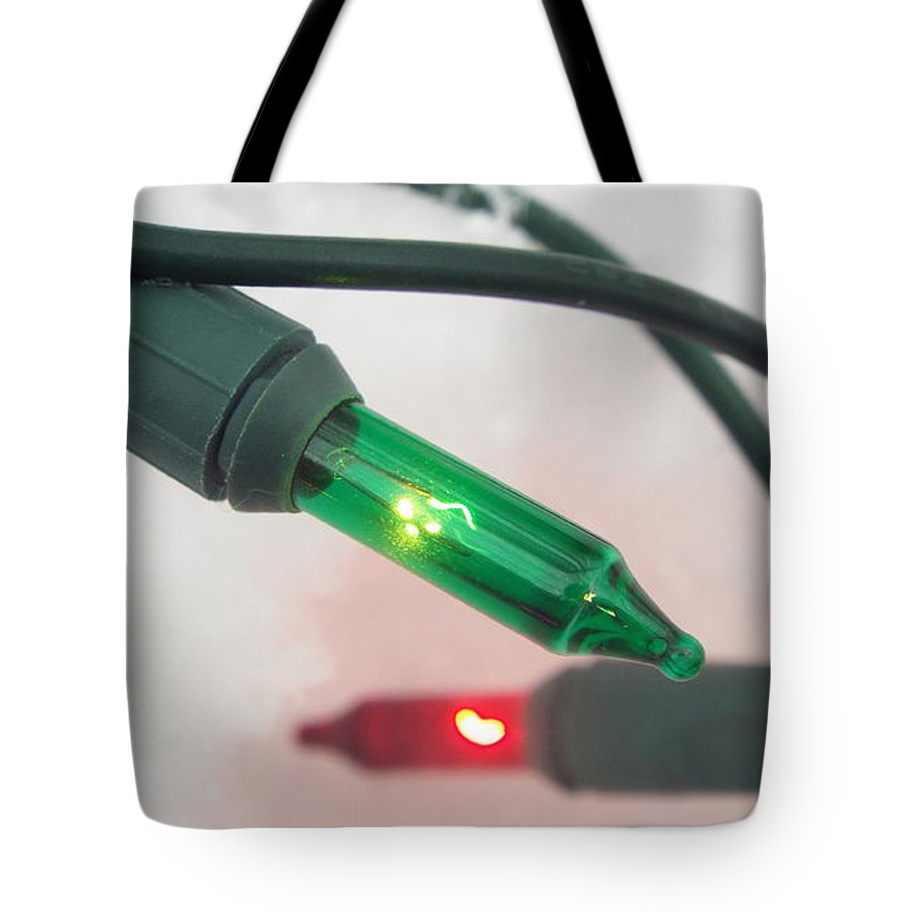 Christmas Tote Bag featuring the photograph Christmas Fairy Lights On Snow by Isabelle Haynes
