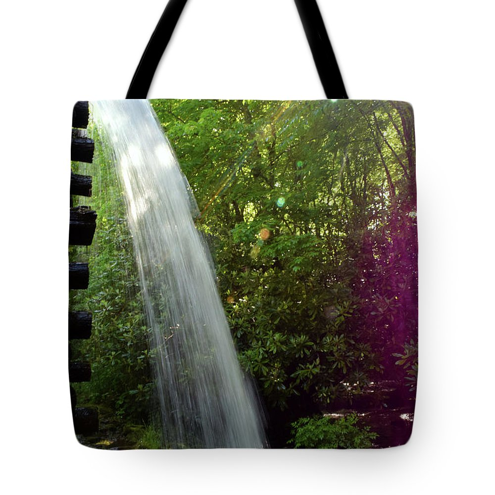 Pat Tote Bag featuring the photograph 900 by Pat Turner