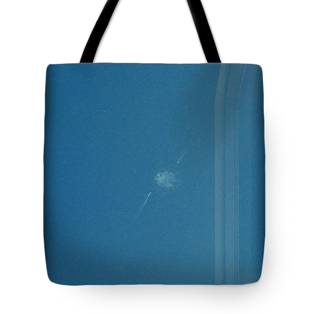 Fenestration Tote Bag featuring the photograph A Bird On A Plate Glass Window by Stan Magnan