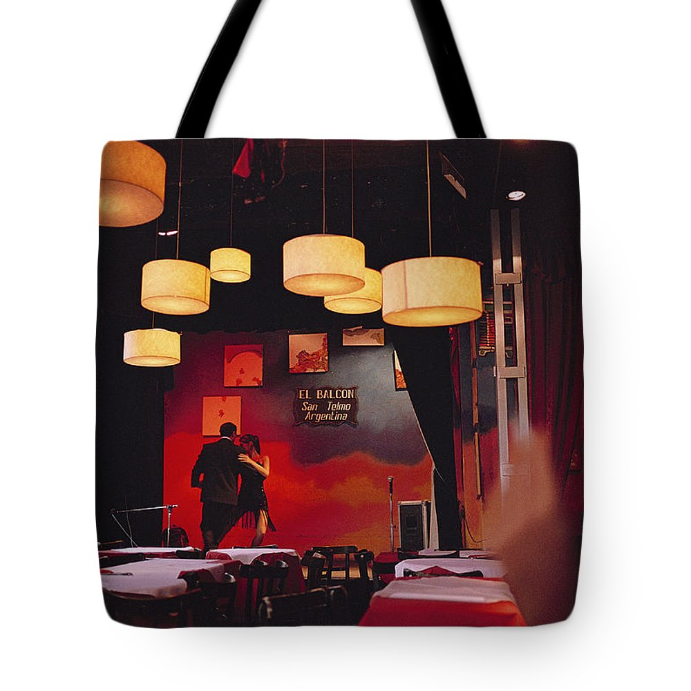 Color Image Tote Bag featuring the photograph A Couple Dances The Tango At A Club by Pablo Corral Vega