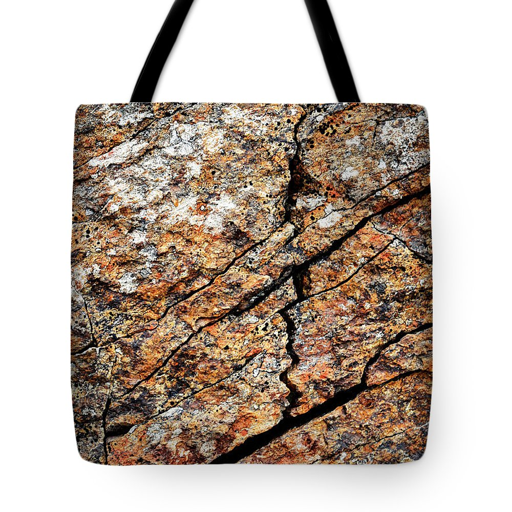 Shape Tote Bag featuring the photograph A Crack On A Brown Stone Block by Jozef Jankola