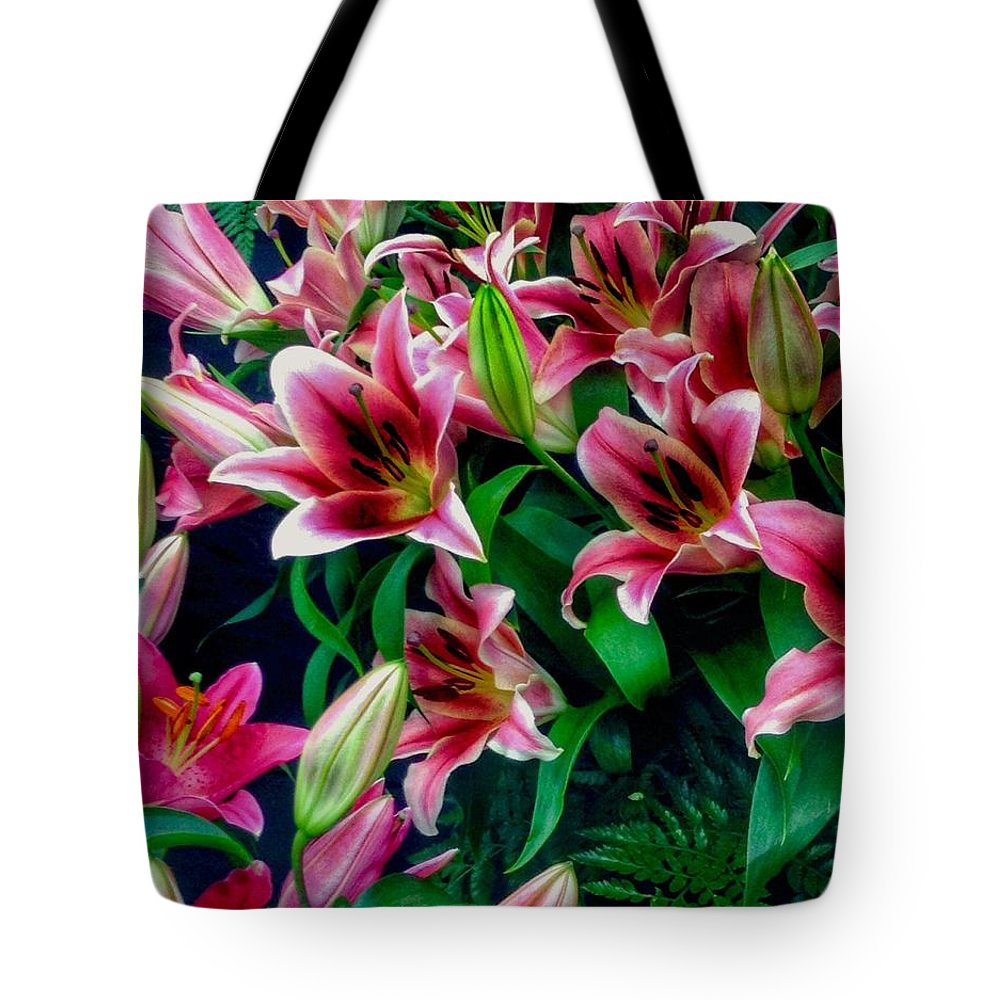 Pink Lilies Tote Bag featuring the photograph A Display Of Lilies by Joan-Violet Stretch