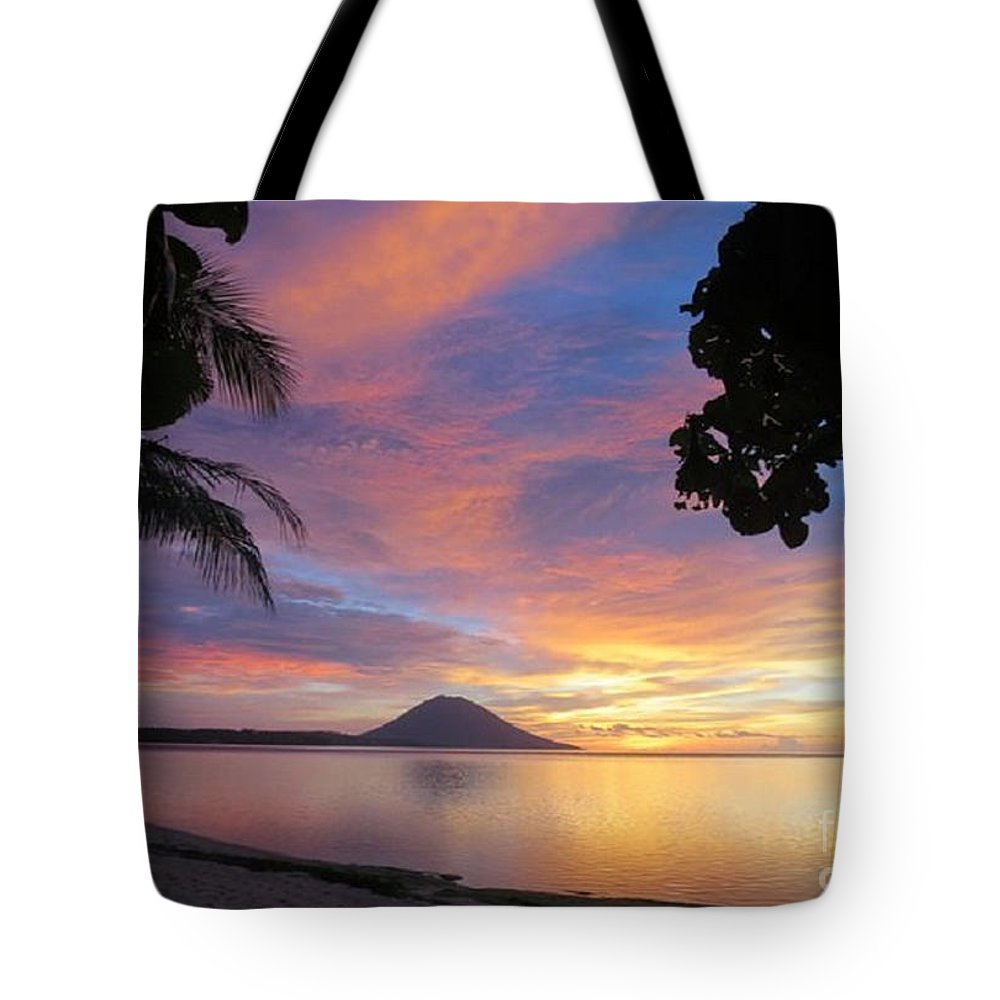 Tropics Tote Bag featuring the photograph A Distant Island by Rod Jellison
