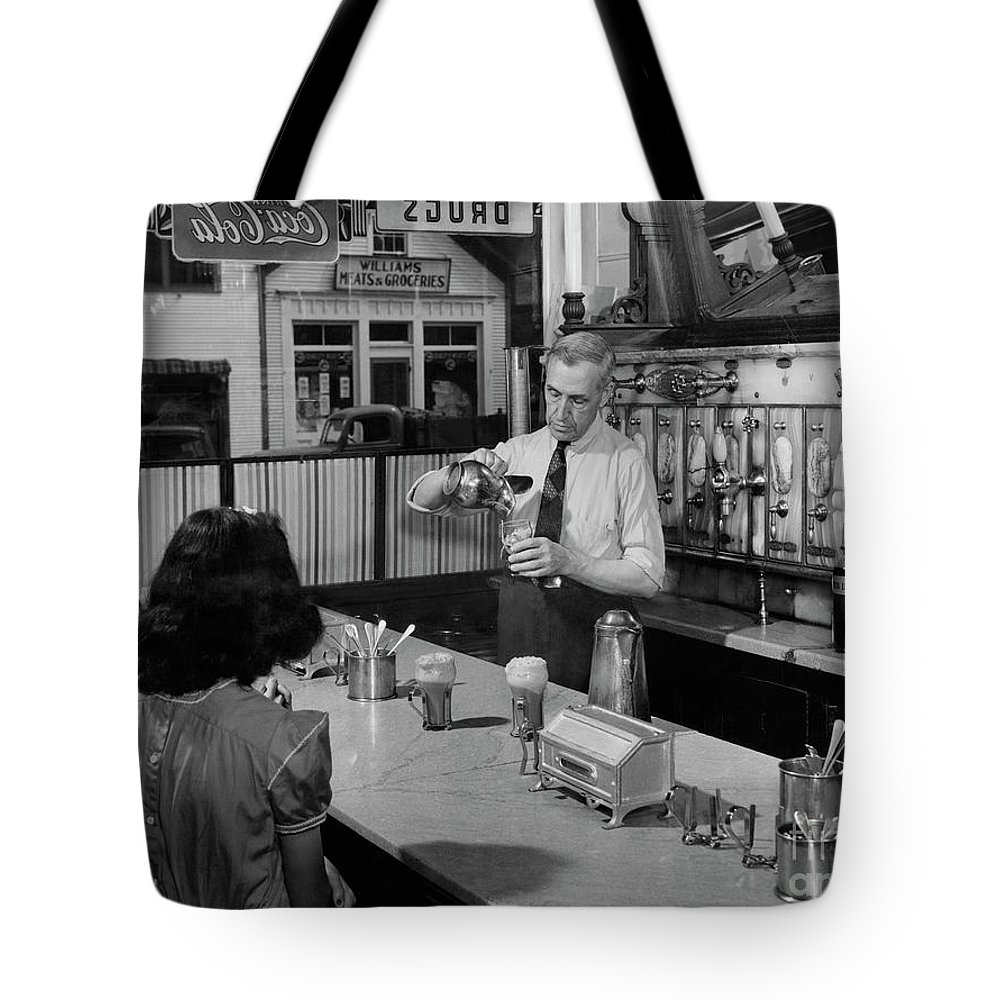 Beverages Tote Bag featuring the photograph A Druggist Prepares Ice Cream Floats At A Soda Fountain by B Anthony Stewart