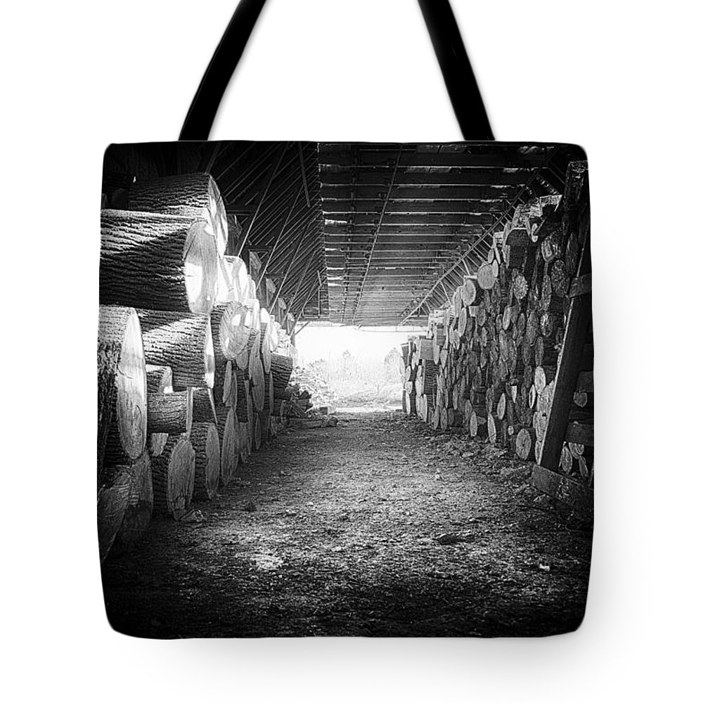 Farm Tote Bag featuring the photograph Farmer's Woodpile At Lusscroft Farm In Black And White by John Prause