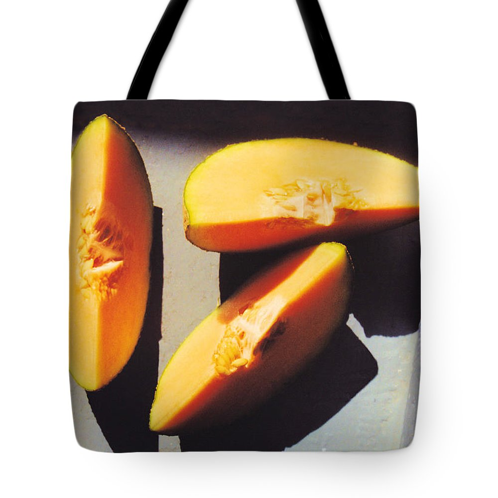 Still Life Tote Bag featuring the photograph A Few Slices by Jan Amiss Photography