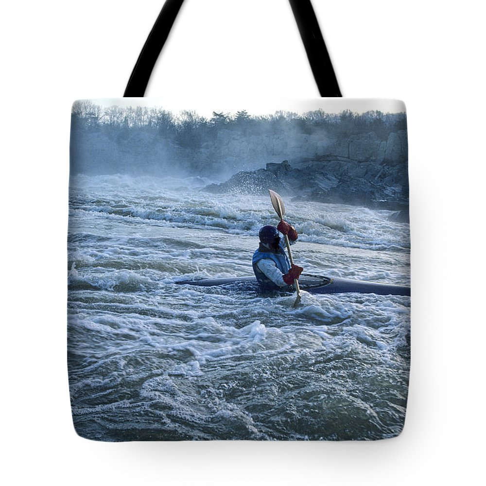 Skill Tote Bag featuring the photograph A Kayaker Takes On White Water Rapids by Kenneth Garrett