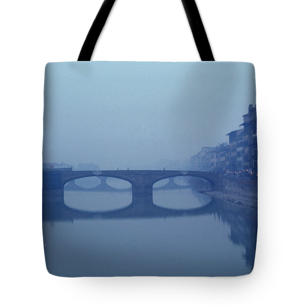 Florance Tote Bag featuring the photograph A Lone Boat On The Arno River by Bill Hatcher