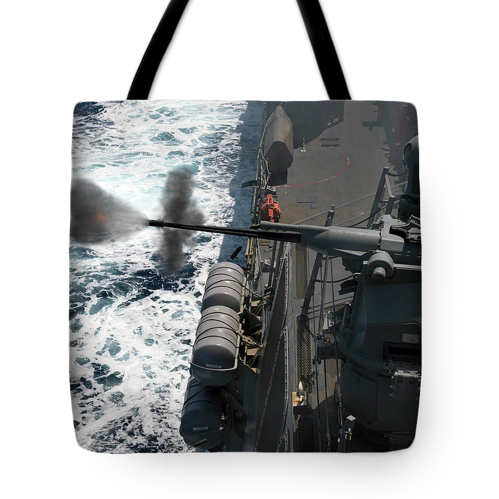 Military Tote Bag featuring the painting A Mark 38 Mod 2 25 Mm Machine Gun Is Fired by Celestial Images