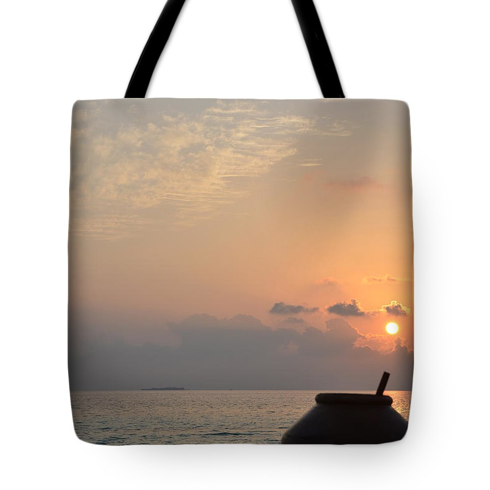 Sunrise Tote Bag featuring the photograph A New Beginning by Corinne Rhode