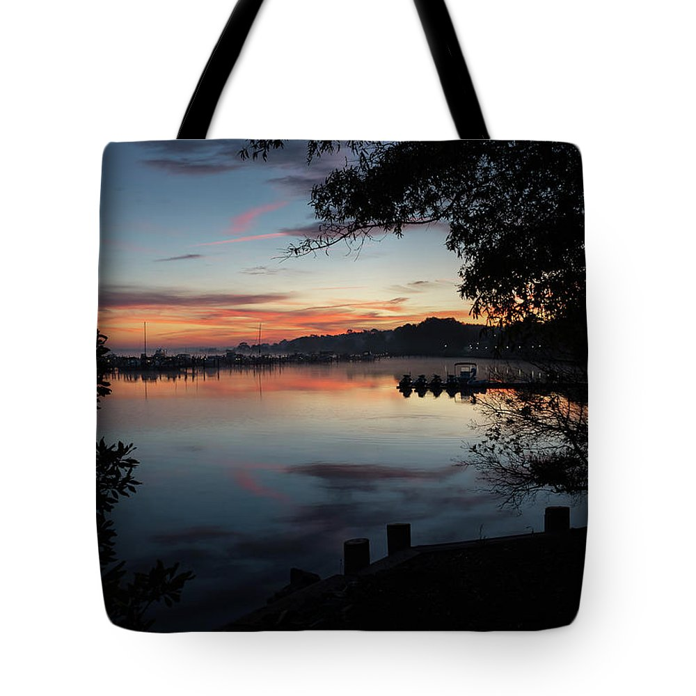 Silhouette Sunrise Tote Bag featuring the photograph A New Day... by Richard Macquade