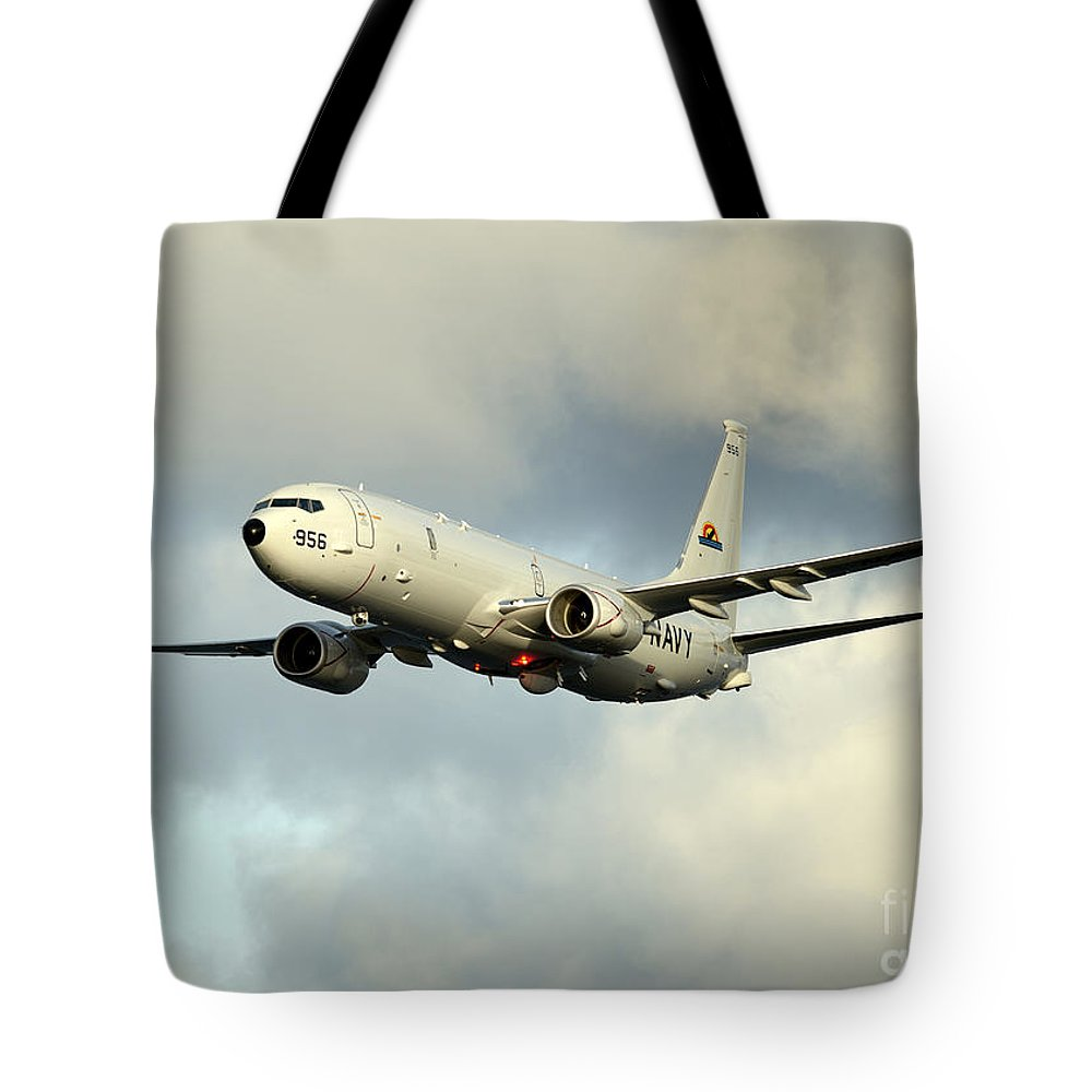 Exercise Bold Alligator Tote Bag featuring the photograph A P-8a Poseidon In Flight by Stocktrek Images