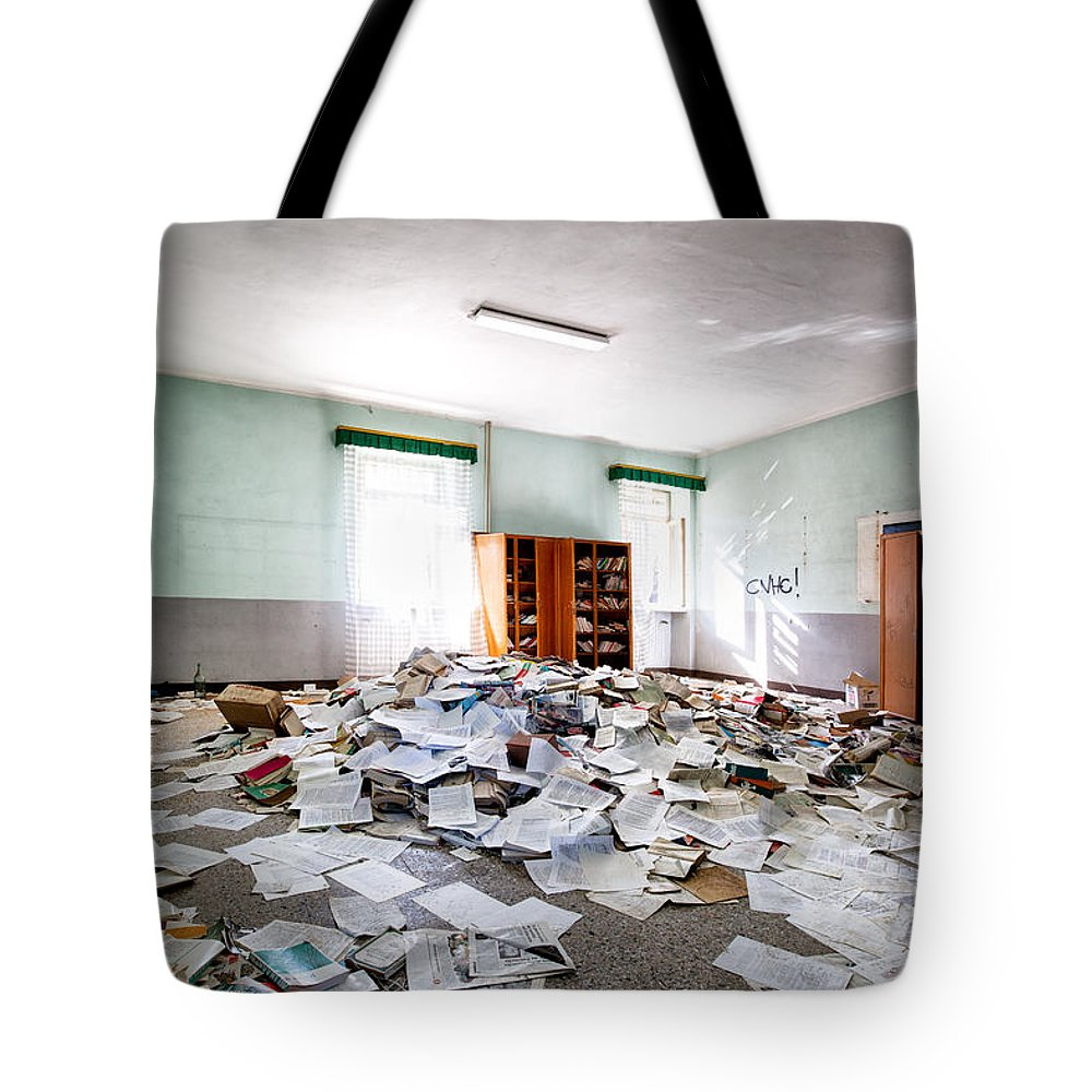 Abandoned Tote Bag featuring the photograph A Pile Of Knowledge - Abandoned School Building by Dirk Ercken
