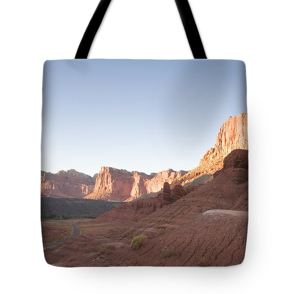 Erosion Tote Bag featuring the photograph A Road Snakes Through The Parks Cliffs by Taylor S. Kennedy