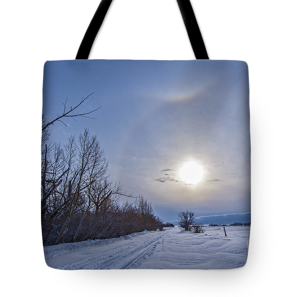 Alberta Tote Bag featuring the photograph A Solar Halo Around The Sun At The End by Alan Dyer